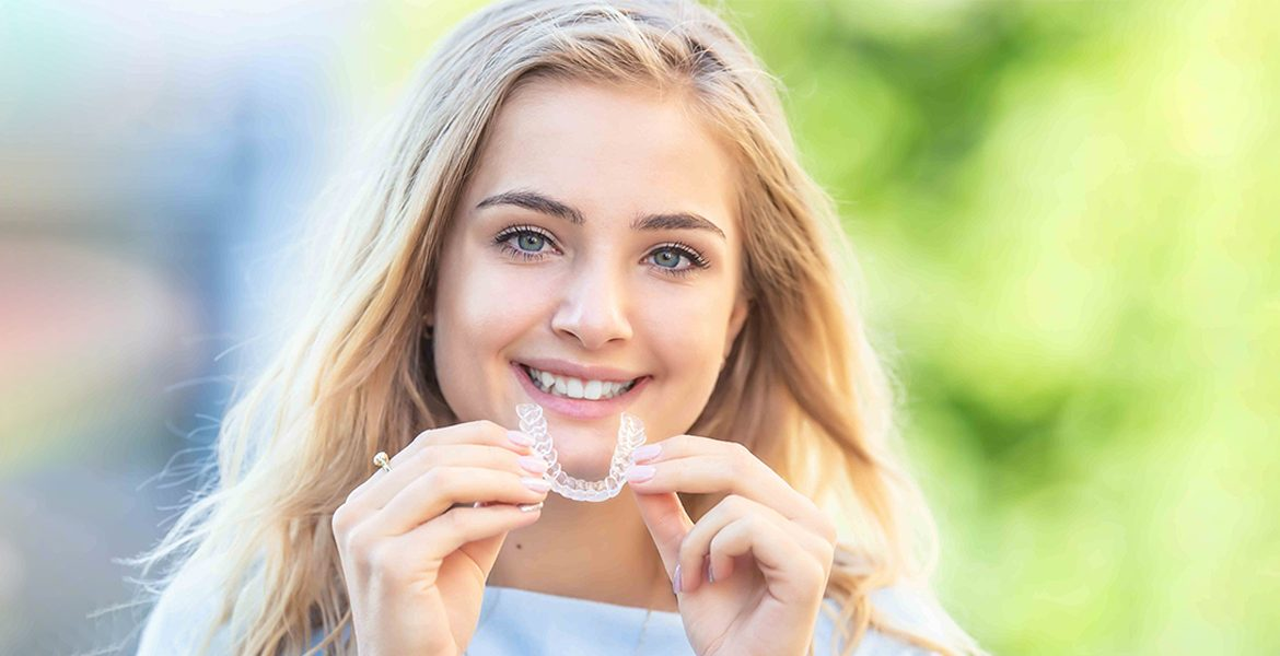 Invisalign in hands of a girl